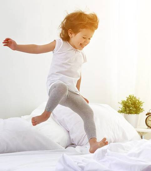 Happy child girl jumps and plays