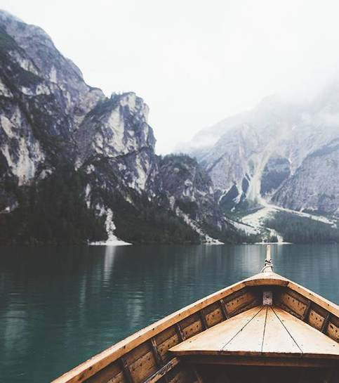 Wooden boat in Braies lake