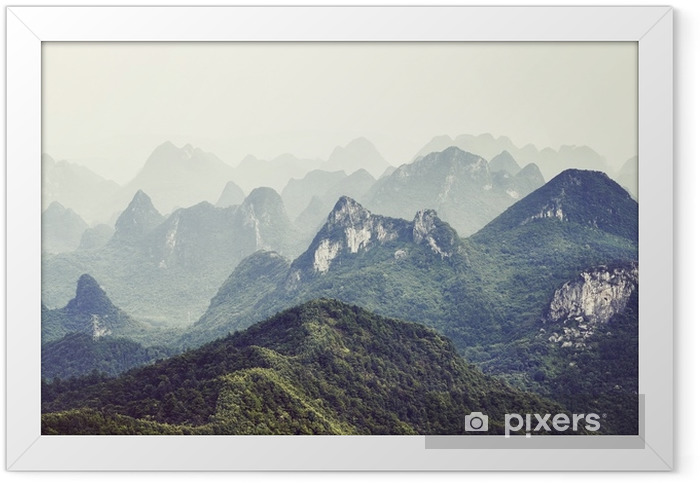 Retro toned picture of karst formations landscape around Guilin on a foggy day. It is one of China most popular tourist destinations. Framed Poster - Landscapes
