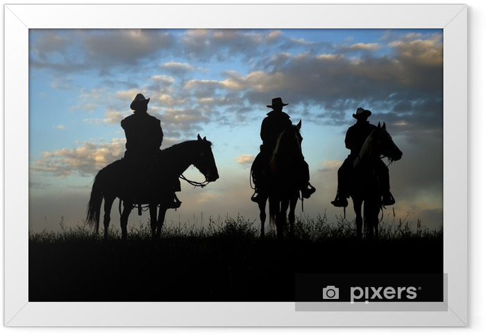 Three cowboys on horseback silhouetted against dawn sky Framed Poster - Men
