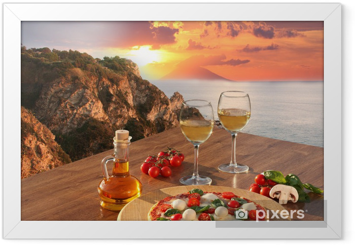 Italian pizza and glasses of wine against Calabria coast, Italy Framed Poster - Themes