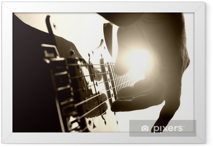 Guitarist plays on stage. Closeup view Framed Poster - Themes