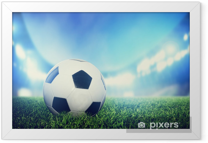 Football, soccer match. A leather ball on grass on the stadium Framed Poster - Destinations