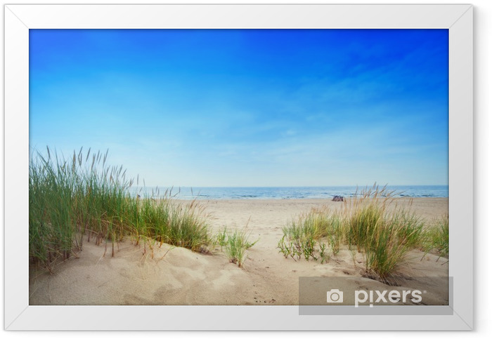 Calm beach with dunes and green grass. Tranquil ocean Framed Poster - Destinations