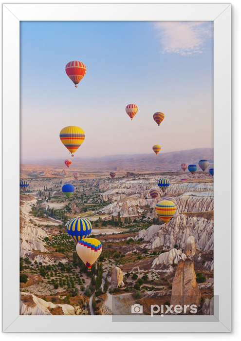 Hot air balloon flying over Cappadocia Turkey Framed Poster - Mountains