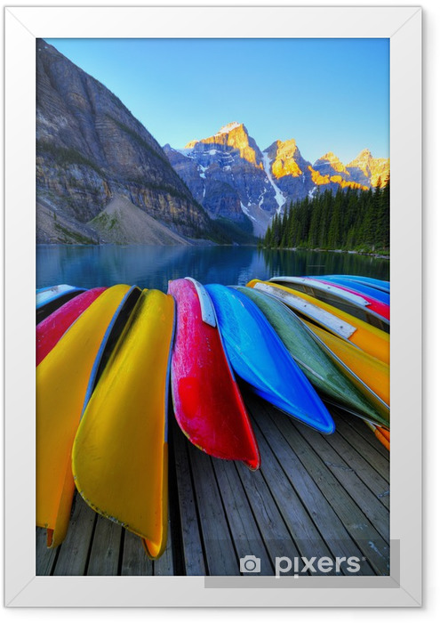 Canoes rest on the dock of Lake Moraine, Banff, Canada Framed Poster - Mountains