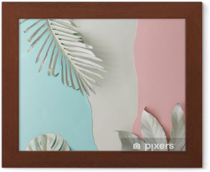Lámina Enmarcada Diseño creativo hecho de hojas tropicales pintadas de blanco y fondo de papel azul y rosa pastel. Minimo tendido plano. - Plantas y flores