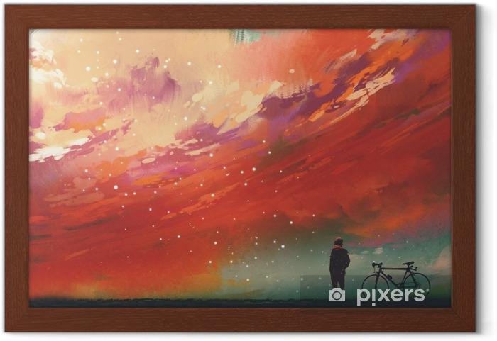 Ingelijste Poster Man met fiets staande tegen rode wolken in de lucht, illustratie, digitale schilderkunst - Hobby's en Vrije tijd