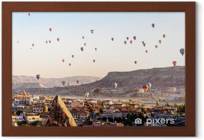 Hot air balloon flying over valleys in Cappadocia Turkey Framed Poster - Travel