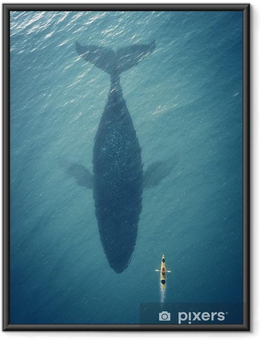 Mies veneessä kelluu iso kala, valas. Kehystetty juliste -