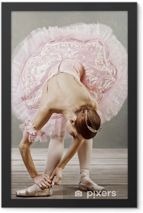 Young dancer in beautiful tutu fixing her slippers Framed Poster - Themes