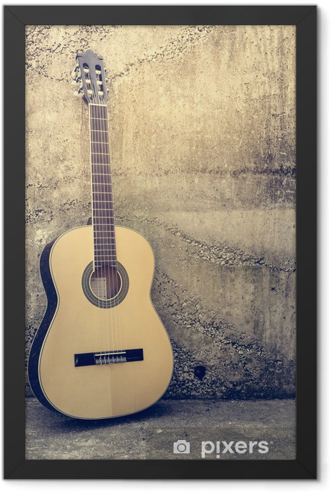 Acoustic guitar against a grunge textured wall. Framed Poster - Themes