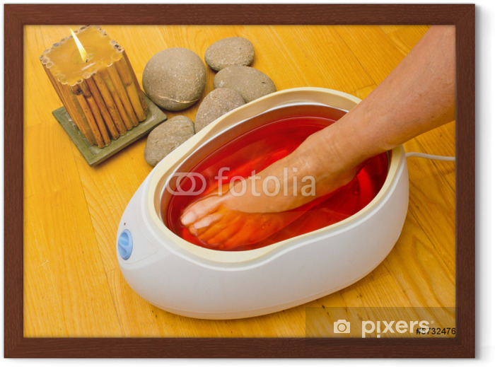 woman foot in paraffin bath at the spa Framed Poster - Lifestyle>Body Care and Beauty