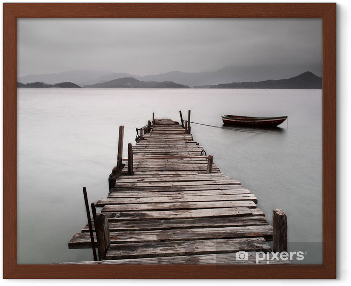 Looking over a pier and a boat, low saturation Framed Poster -