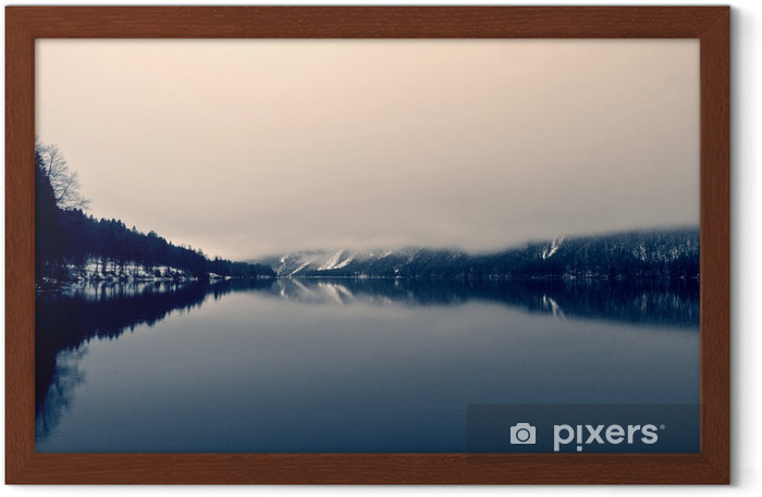 Snowy winter landscape on the lake in black and white. Monochrome image filtered in retro, vintage style with soft focus and red filter; nostalgic concept of winter. Lake Bohinj, Slovenia. Framed Poster - Landscapes
