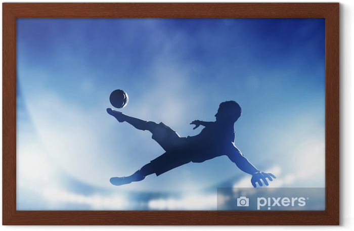 Football, soccer match. A player shooting on goal Framed Poster - Themes