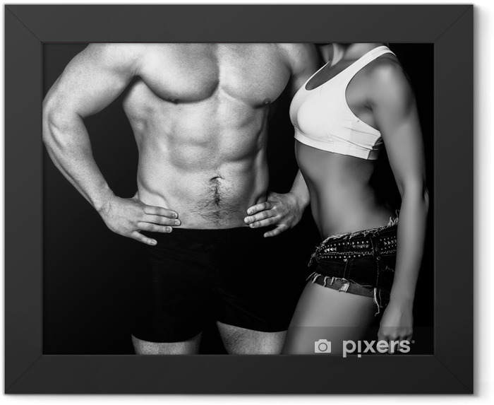 Strong woman and man against a black background Framed Poster - Destinations