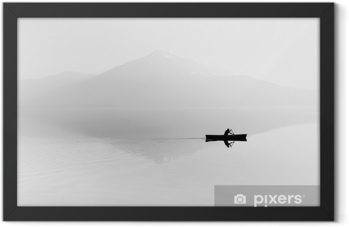 Fog over the lake. Silhouette of mountains in the background. The man floats in a boat with a paddle. Black and white Framed Poster - Hobbies and Leisure