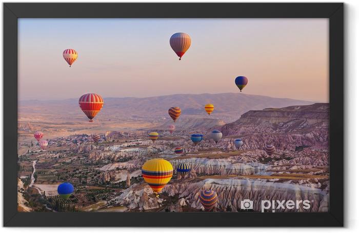 Hot air balloon flying over Cappadocia Turkey Framed Poster - iStaging