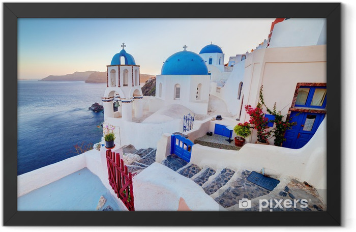Oia town on Santorini island, Greece at sunset. Aegean sea. Framed Poster - Themes