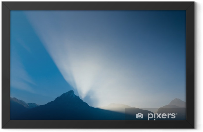 Grandiose game of light and shadow. Sun set behind the mountain peaks. Framed Poster - Landscapes