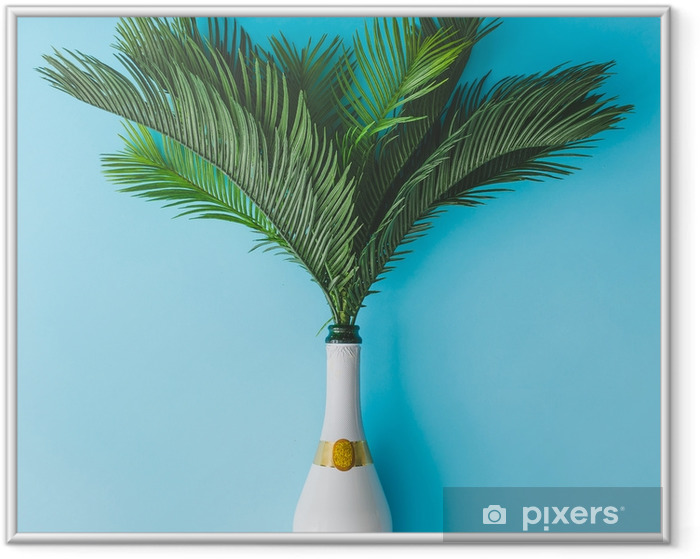 Champagne bottle with tropical green palm leaves on pastel blue background. Summer holiday concept with creative copy space. Summer tropical celebration party flat lay. Framed Picture - Lifestyle