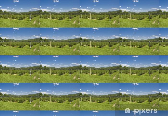 Vinylová tapeta na míru Borůvkové plantáže s horami v pozadí - Venkov