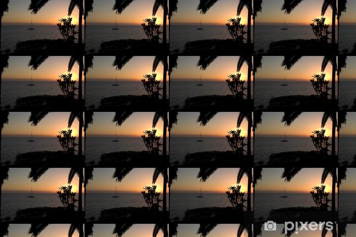 Papier peint vinyle sur mesure Coucher de soleil avec un bateau et palmiers - Ciel