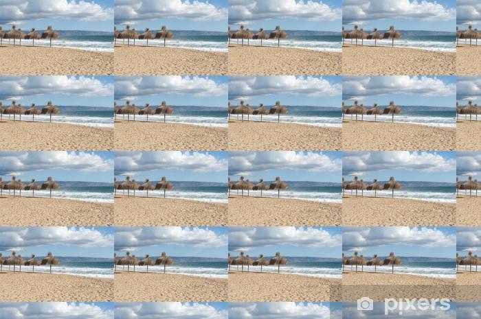 Vinylová tapeta na míru Přírodní slunečníky na pláži - Voda