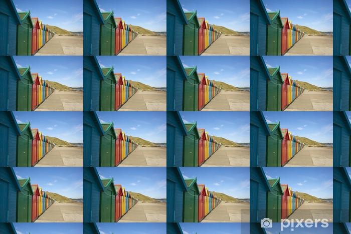 Papier peint vinyle sur mesure Cabines de plage colorées - Eau