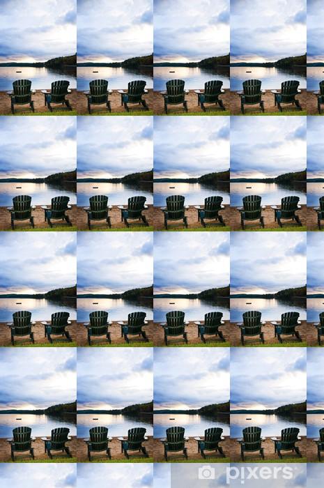 Tapeta na wymiar winylowa Drewniane krzesła o zachodzie słońca na plaży - Woda