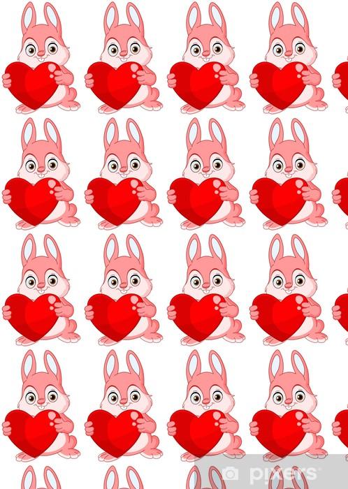 Papier peint vinyle sur mesure Mignon lapin rose tenant un coeur - Mammifères