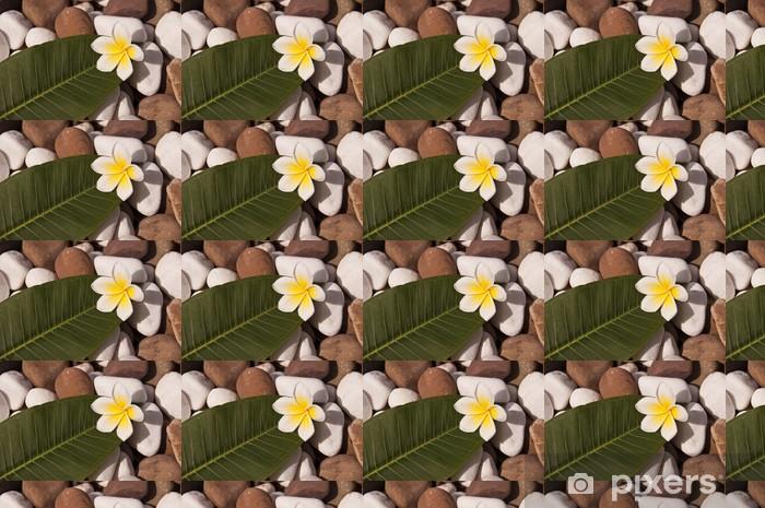 Papier peint vinyle sur mesure Galets et fleur de frangipanier - Vacances