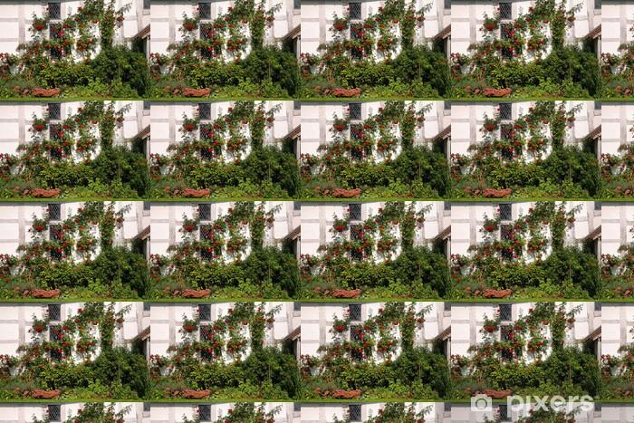 Vinyl behang, op maat gemaakt Rode Klimrozen op een middeleeuws herenhuis - Bloemen