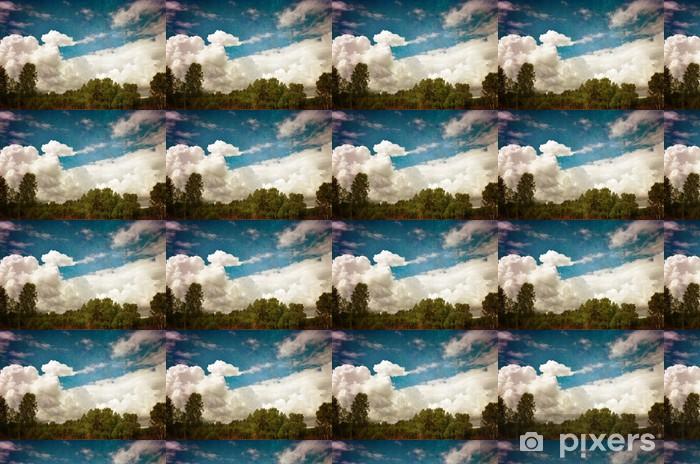 Vinylová tapeta na míru Zelené lesy proti modré zatažené obloze - Nebe
