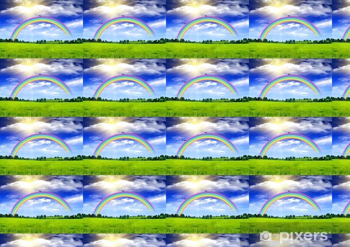 Vinyltapete nach Maß Regenbogen in den blauen Himmel über einer Lichtung - Hintergründe