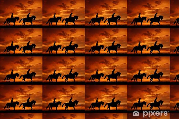 Vinylová tapeta na míru Jezdci na koních v západu slunce - Savci