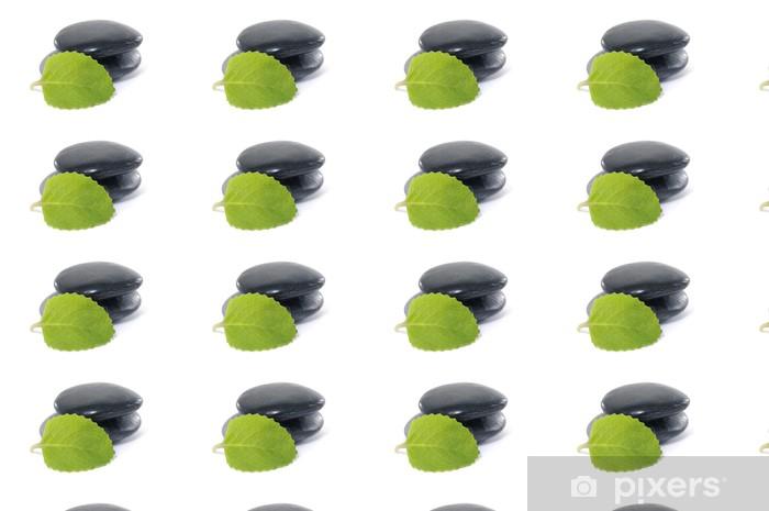 Tapeta na wymiar winylowa Wyważone czarny zen kamyki i młody zielony liść - Uroda i pielęgnacja ciała