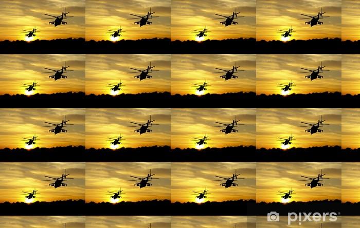 Papier peint vinyle sur mesure Silhouettes d'hélicoptères sur fond coucher de soleil - Violence et criminalité
