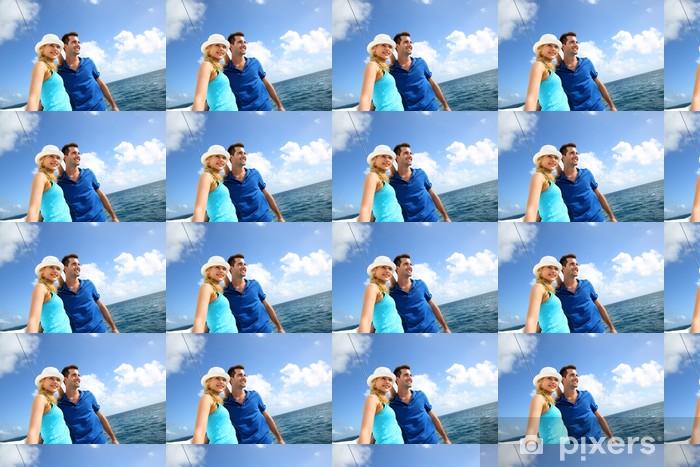 Vinylová tapeta na míru S úsměvem bohatý mladý pár na plachetnici v karibském moři - Vodní sporty