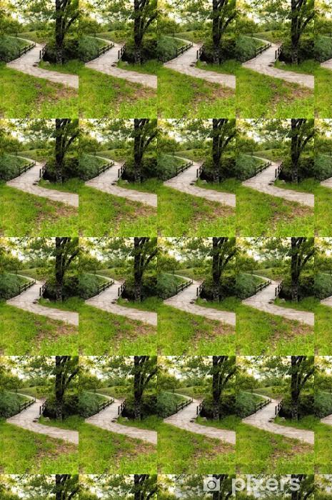 Vinylová tapeta na míru Kamenná cesta v lese - Vertical - Outdoorové sporty