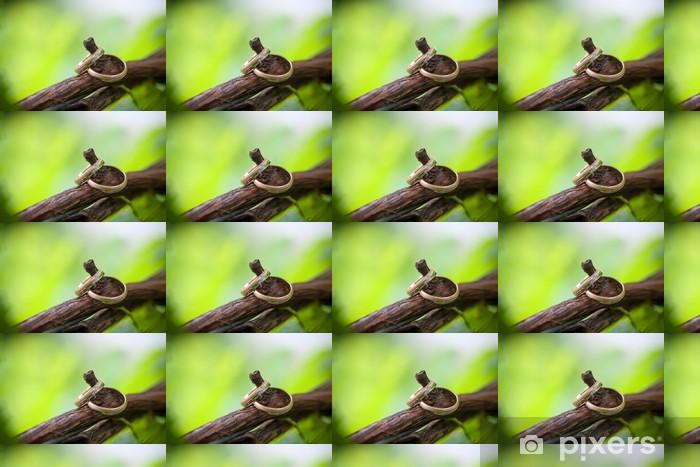 Papel de parede em vinil à sua medida Two wedding rings on a vine branch - Moda