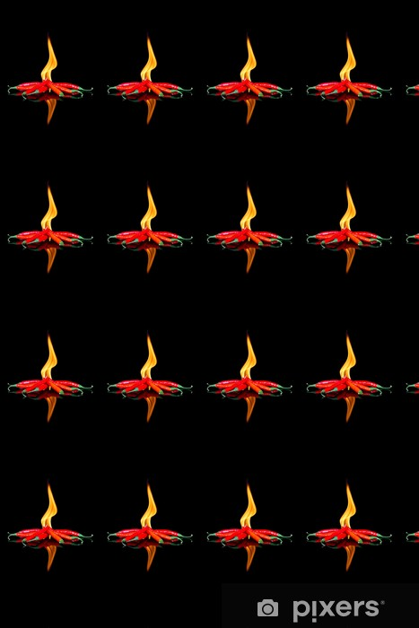 Vinylová Tapeta Červené chilli na černém povrchu s plameny - Koření a bylinky