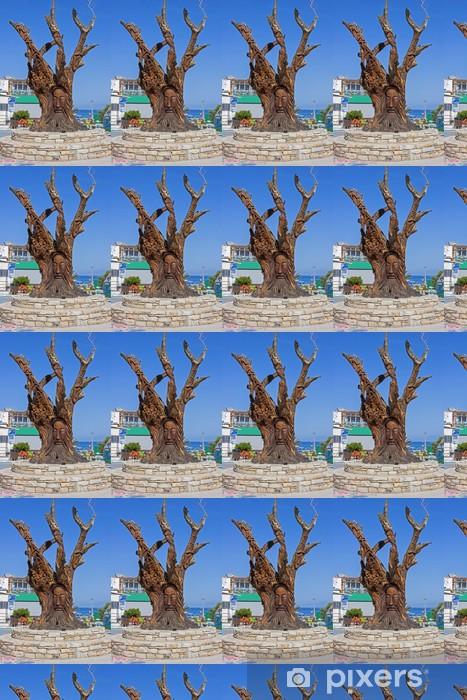 Tapeta na wymiar winylowa Drzewa rzeźbione w Matala, miasta hippie jest - Europa