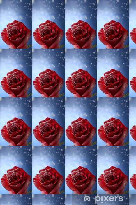 Papier peint vinyle sur mesure Rose rouge dans la neige sur fond bleu - Fleurs