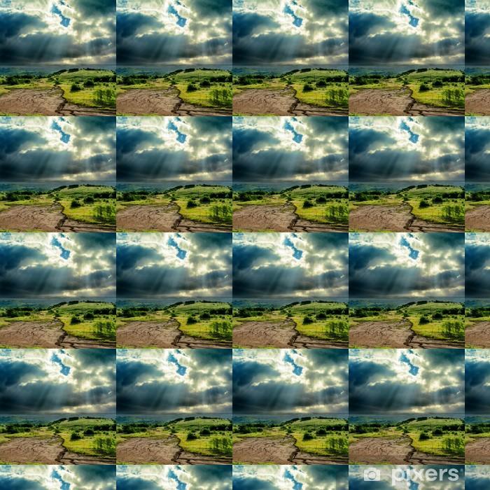Tapeta na wymiar winylowa Ciemne dramatyczne niebo nad górskich z erozją - Niebo