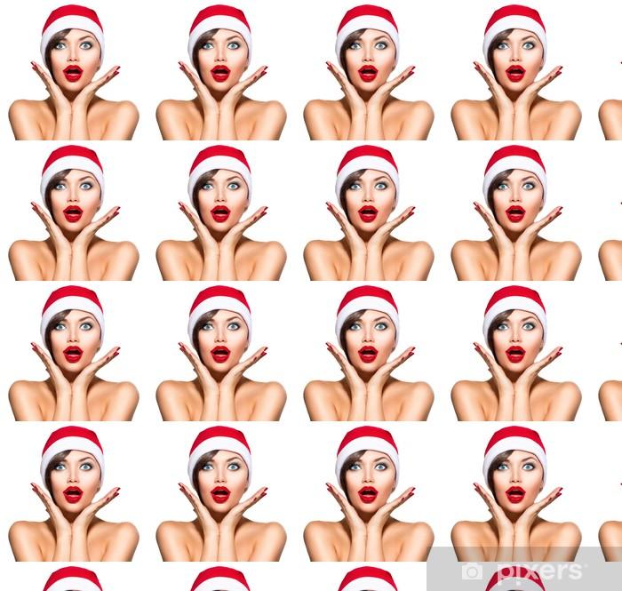 Christmas Woman. Beauty Model Girl in Santa Hat over White Vinyl custom-made wallpaper - International Celebrations