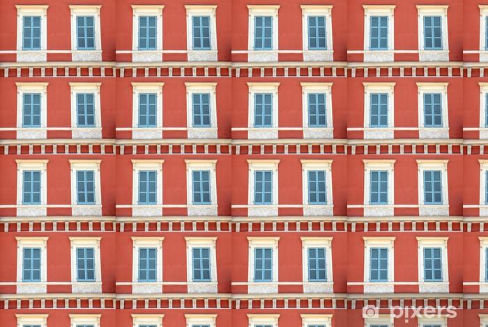 Vinylová tapeta na míru Stará francouzská modrá okna závěrky v červeném domě, Nice, Francie. - Evropa