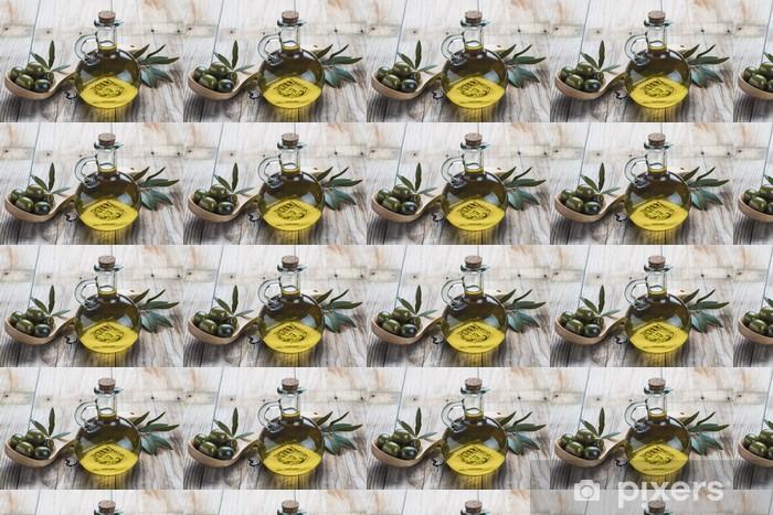 Tapeta na wymiar winylowa Oliwa z oliwek i oliwki na drewnianą łyżką - Oliwki