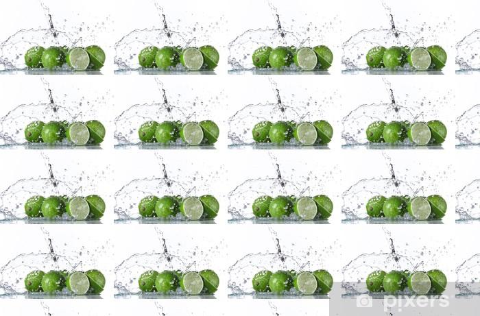 Papier peint vinyle sur mesure Limes avec les projections d'eau - Repas